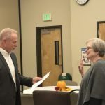 Dana administers the oath of office to Susan