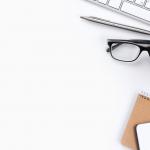 computer keyboard, pen, glasses, cactus, notebook