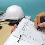 worker completing an inspection