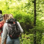 people hiking on a trail with backpacks