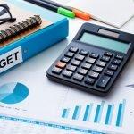budget binder, charts, calculator