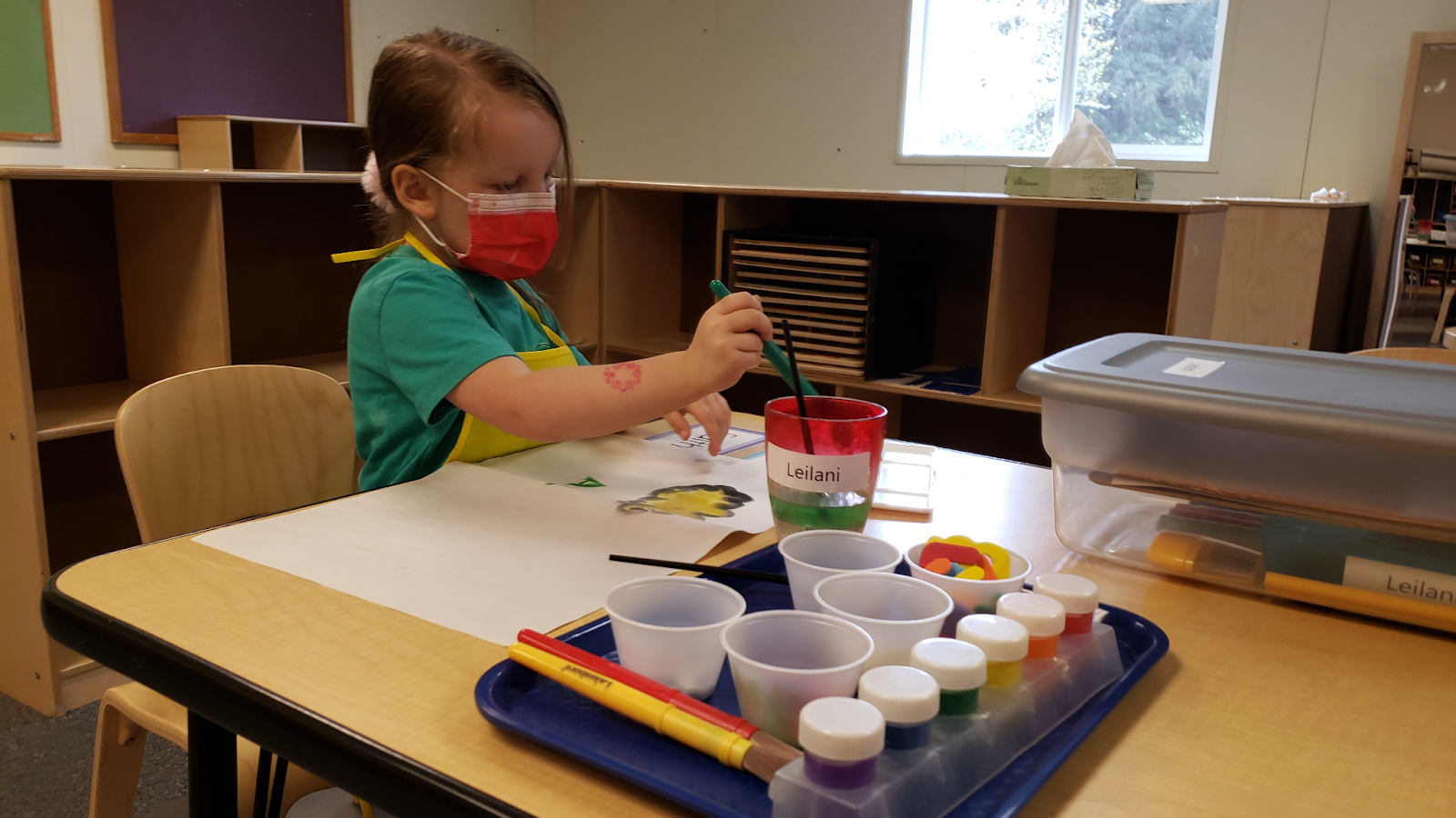 Child painting with water colors