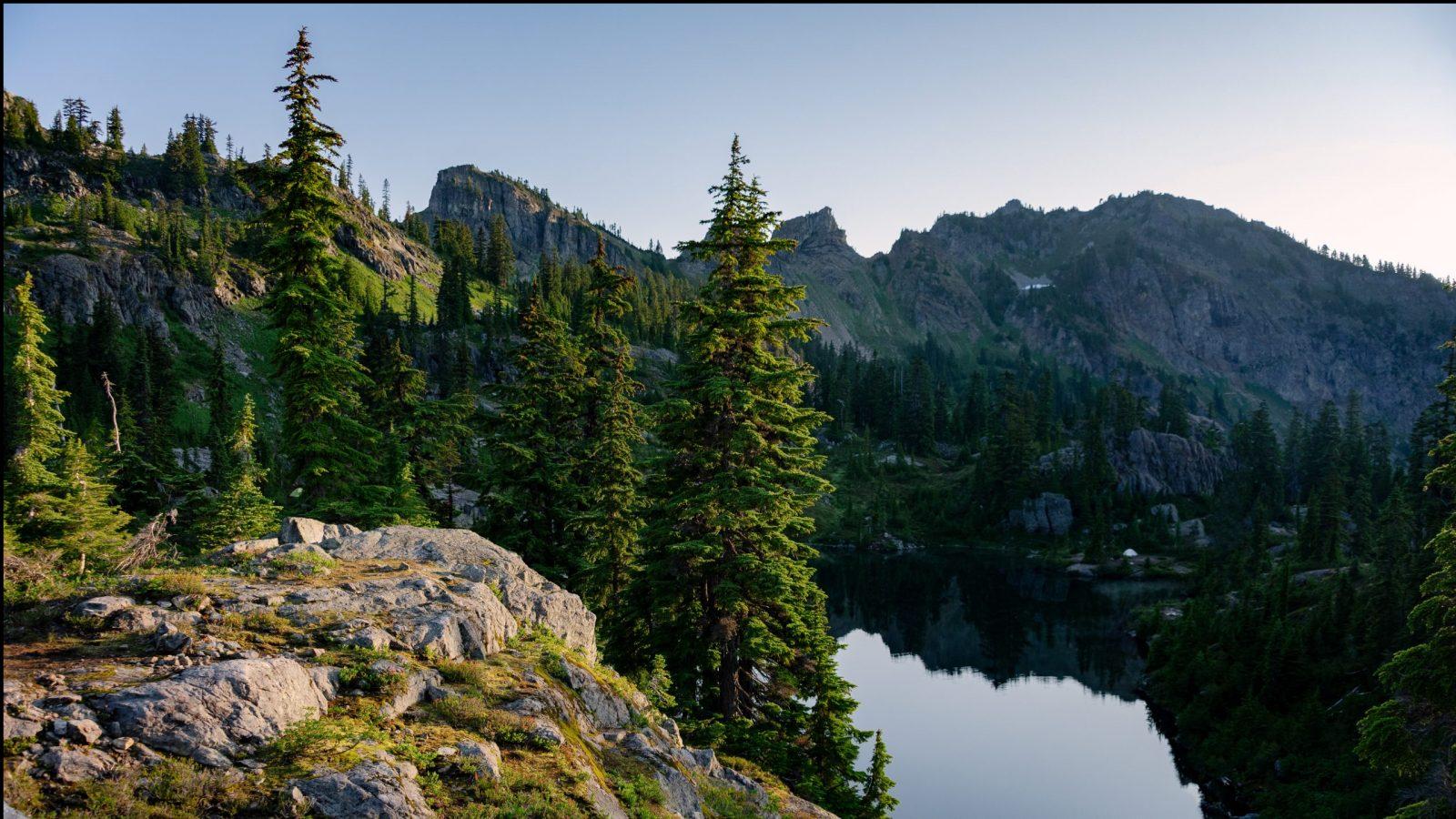 Sunrise at Lila Lake in the Alpine Lake Wilderness. Central Cascade mountain range, Washington State, July 2019.